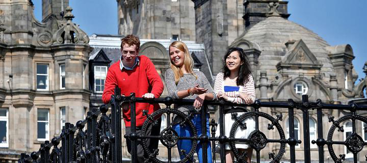 Photo of students in front of the Balmoral Hotel in the city centre